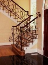 wrought iron interior rail with a mahogoney caprail