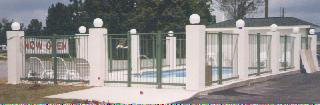 security fence around motel swimming pool