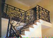 forged iron rail with bronze handrail