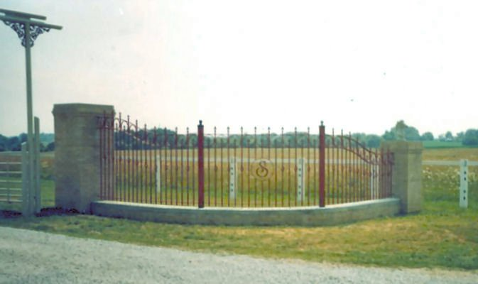 arched and curved wrought iron entrance fence