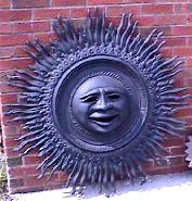 large cast aluminum sun wall plaque