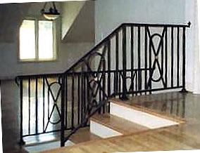 wrought iron railing with bronze rosettes