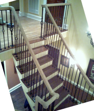 wrought iron railing with oak handrail