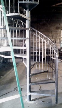 wrought iron spiral staircase during manufacturing